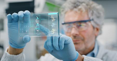 Portrait of a futurist researcher using the augmented reality screen. Shot in 8K. Concept of futuristic medicine and science Archivio Fotografico