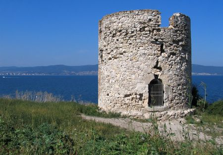 ruinous: The ruinous tower on the ancient Bulgarian town Nessebar which located on a peninsula near Golden Beach sea resort.
