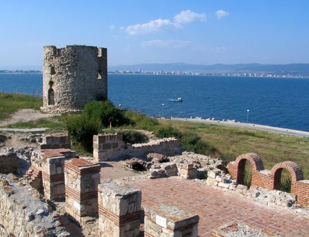 ruinous: The ruinous tower with wall on the ancient Bulgarian town Nessebar which located on a peninsula near Golden Beach sea resort.