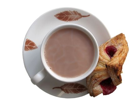 A cocoa cup and a napoleon with red raspberry jam photo