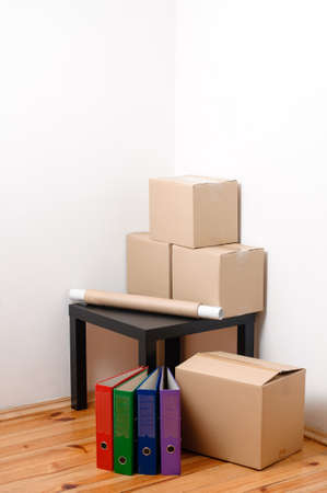 Moving day - cardboard boxes with table and files in room