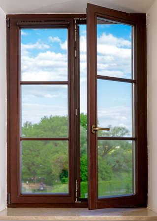 wood plastic vinyl window on a background blue sky