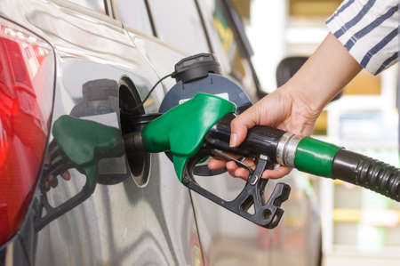 Fuel nozzle to refill fuel in car at gas station
