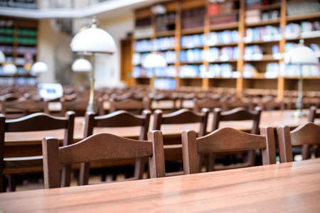 tables for reading books in library hall (Shallow depth of field) Stock Photo