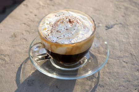cappuccino cup on the gray stone background Banco de Imagens
