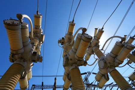 high voltage: Electric substation in a bright sunny day with the blue sky Stock Photo