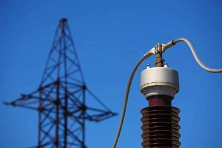 Electric insulator on the blue sky background Stock Photo