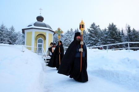 cassock: Religious procession on a Christian holiday of the Epiphany in Antoniyevo-Dymsky monastery, the Leningrad region, near St. Petersburg, Russia,- 19 January 2013.