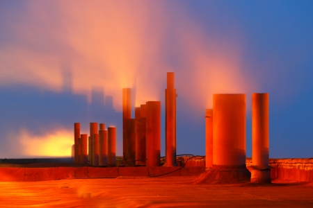 Smoking pipes of factory with night illumination photo