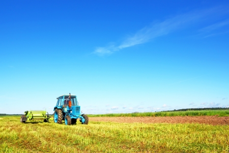 agriculture machinery: Tractor on a farmer field