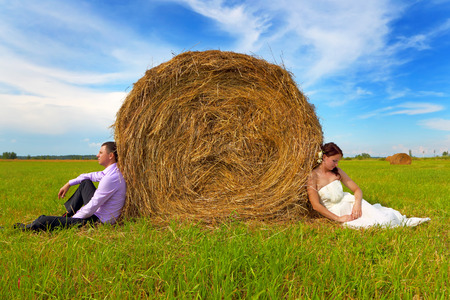 Groom and bride in the field photo