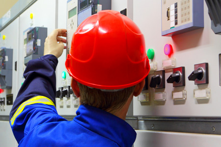 manual job:  Worker in a helmet, the electrician