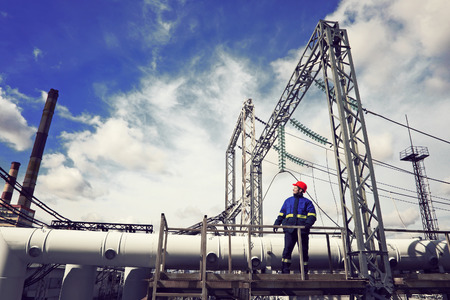 fuel and power generation: The worker at power plant Stock Photo