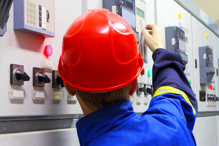 Worker in a helmet, the electrician photo