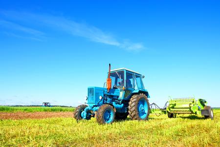Tractor on a farmer field photo