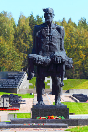 KHATYN, BELARUS- 16 September ,2014:Monument The unsubdued person (the man with the dead child on hands) in Khatyn, Belarus on September 16, 2014.Khatyn - a monument to the victims of Nazism.