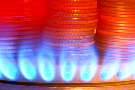 Payment for gas. Money and gas torch photo