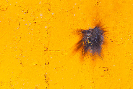Colored yellow sheet of iron. Industrial abstract background.