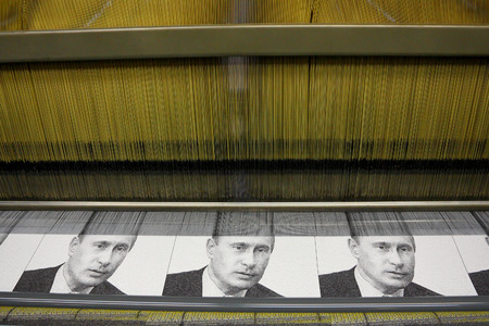 guarantor: Vyritsa, Leningrad region, Russia-14 of February, 2012:Portret V. Putin on the weaving loom in Vyritsa, the Leningrad region, Russia, February 14,2012. Factory of portraits of the Russian politicians. Editorial