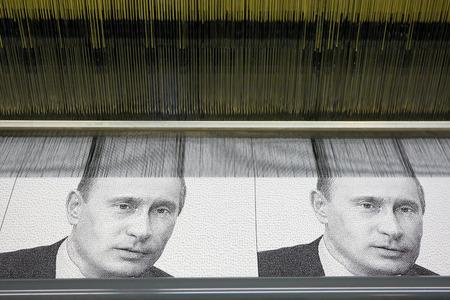 guarantor: Vyritsa, Leningrad region, Russia-14 of February, 2012:Portret V. Putin on the weaving loom in Vyritsa, the Leningrad region, Russia, February 14,2012. Factory of portraits of the Russian politicians. Editorial