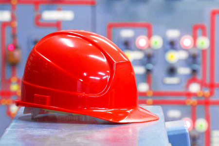 heavy equipment operator: Interior of industrial factory with a helmet