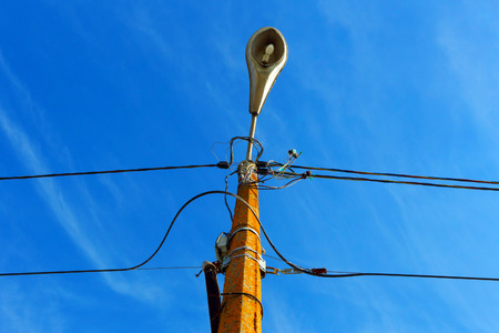 electric line: A street light.Outdated electric line.