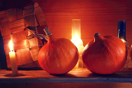 Autumn background. Pumpkins in a rural interior. Halloween.