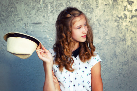 The girl with a hat. Greeting, openness, happiness.Retro toning. Stock Photo