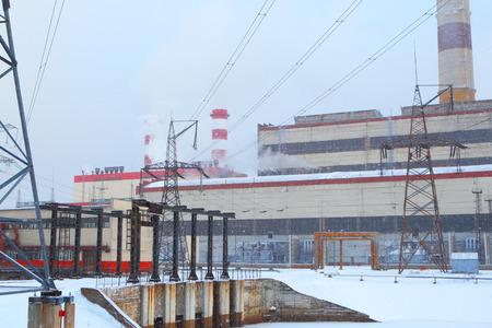 Power station in winter blizzard.