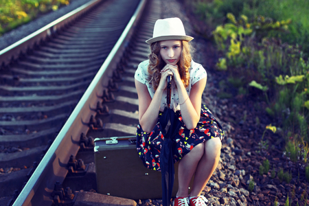 Girl waiting for the train.Photo toned in retro style. Stock Photo