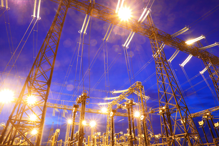 Electrical substation at night.Industrial business. Stock Photo