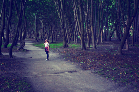 A walk in the Park. Girl dreams. Photo tinted