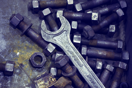 Wrench and nut.Industrial tools. Photo tinted.