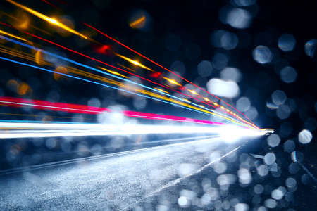 Car headlights. Abstract background of night traffic.
