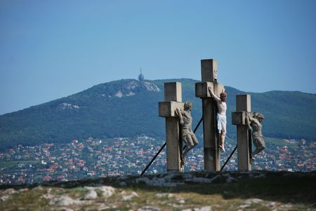 Jesus christ cross on calvary with mountain background