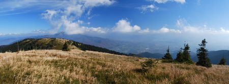 Panorama of alpine meadow with cloudy sky Stock Photo