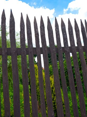Very old brown wooden fence in the garden Stock Photo - 7532330