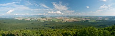 Panorama of forests, meadows and fields under a beautiful sky Stock Photo