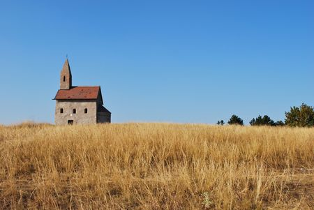 Grassy hill with the dominant Roman church building Stock Photo