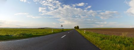 Panorama of the asphalt road in a beautiful sunny autumn day