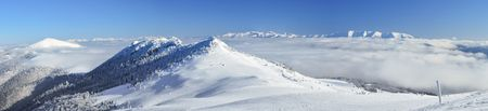 inversion: Cloud inversion and the snowy mountain peaks