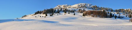 Winter panorama of mountains and beautiful snow fields