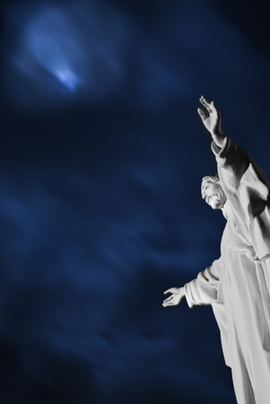 Night scene with a statue of Jesus Christ in the forefront