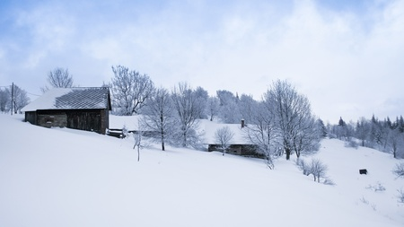 Winter in scenic mountain village covered with snow