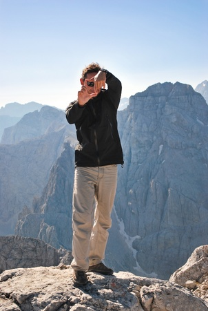 suggests: Guy in the mountains suggests the most suitable composition