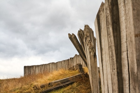palisade: Gloomy skies over the ruins of historic palisade fortifications