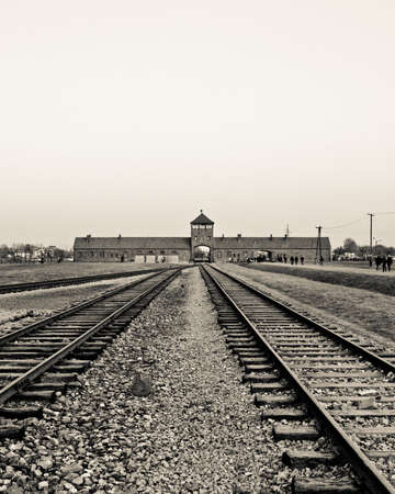 Entrance gate building and rails in to Auschwitz Birkenau camp photo