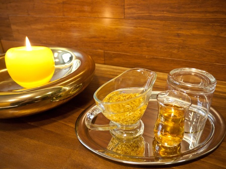 Equipment for luxurious spa treatments with golden oil and honey in a glasses photo