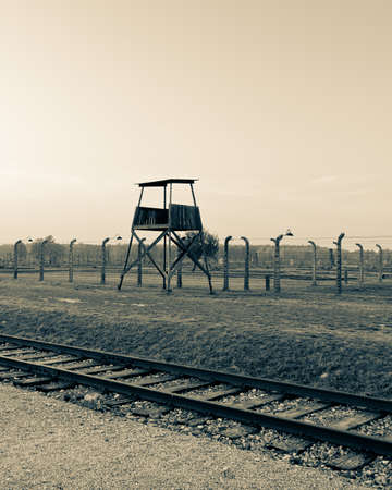 Scenery from Auschwitz with a tower and railway line photo