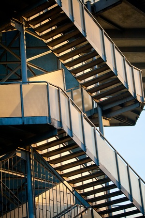Construction of steel blue colored staircase in the rays of the sun photo